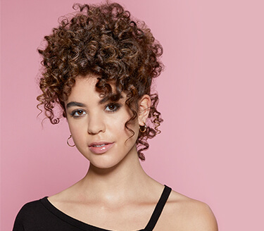 Flaunt Your Natural Curly Hair With The Faux Hawk Look
